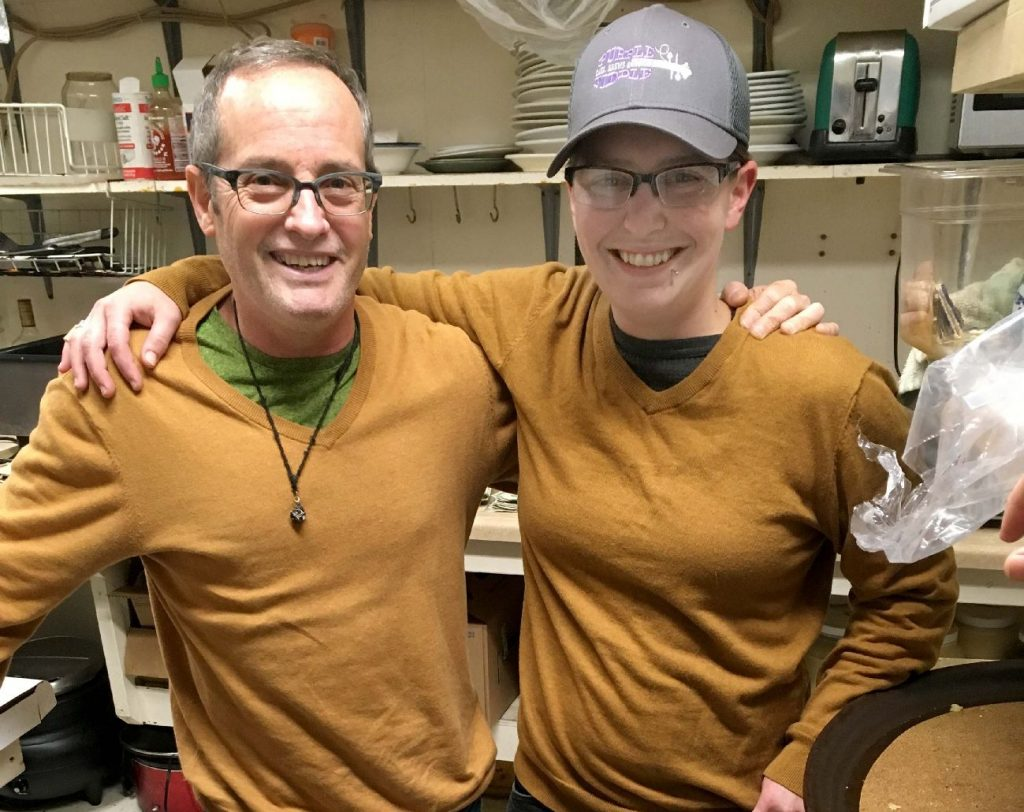 John Bright and employee in Purple Fiddle kitchen